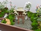 A tiny model of a shrine at an exhibition on the way to th Meiji Shrine
